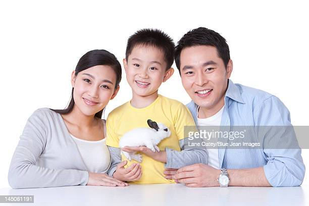 Family playing with rabbit