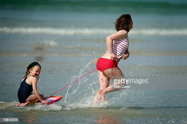 A family plays in the sea as they enjoy the holiday sunshine in Sennen on April 9 2007 in Cornwall England The UK's Easter weekend was blessed with...