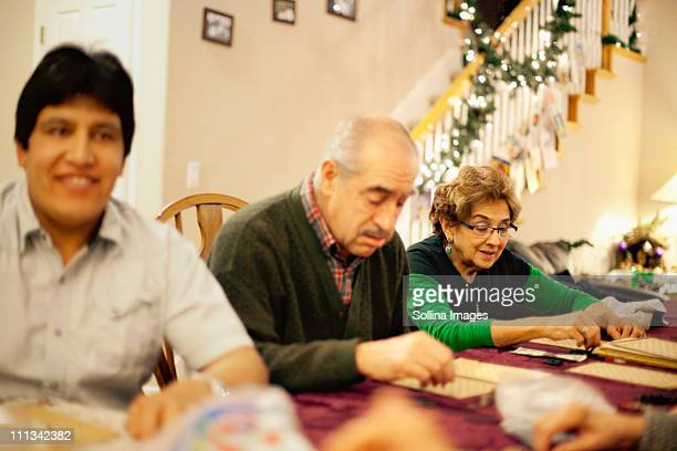 Family plays lotteria a mexican bingo game