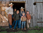 Family portrait against barn in Big Timber, Montana