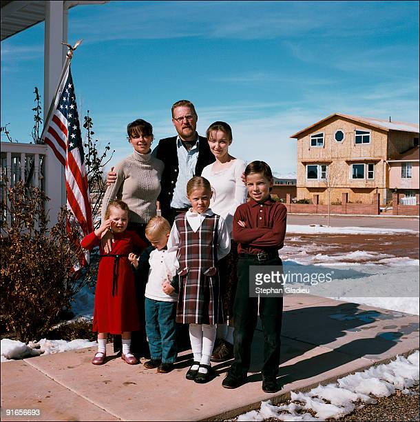 Family portrait Edson Hammon a 35yearold polygamist from Centennial Park a small community of 1500 people at the border of Utah and Arizona poses in...