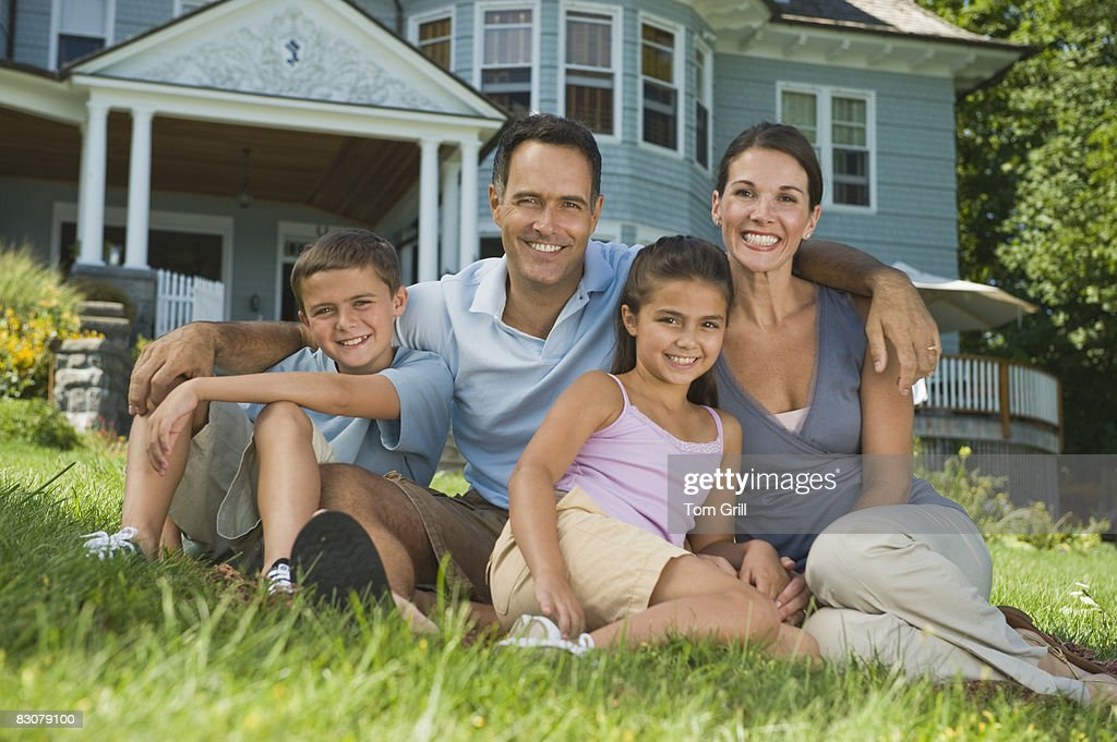 family portrait in front of house