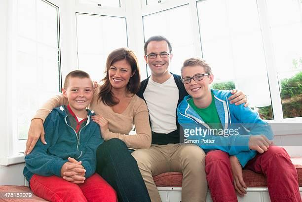 Family portrait in front of window