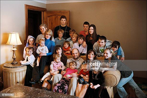 Family portrait of a polygamist family consisting of one father three mothers and 21 children This plural family lives in the Salt Lake Valley among...