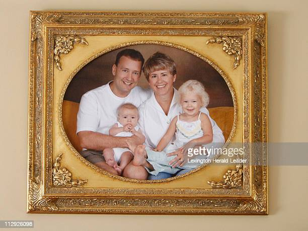 A family portrait of Jeff and Amy Clay with children Sarah left and Shelby right is shown in their home in Burlington Kentucky Thursday August 16...