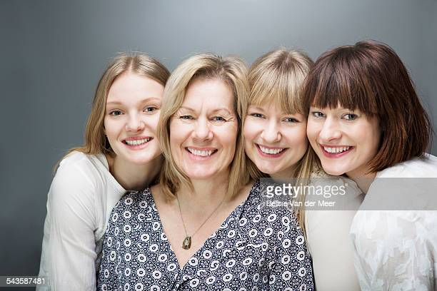 family portrait of mother with daughters.