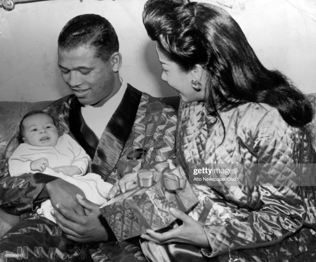 A family portrait of the boxing champion Sugar Ray Robinson with his wife Edna Mae Robinson nee Holly and their newborn son Ray Robinson Jr December...