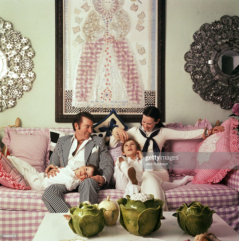 Family portrait of the Coopers as they play on a sofa in their home, Southampton, Long Island, New York, March 30, 1972. American author and actor Wyatt Emory Cooper and heiress <a gi-track='captionPersonalityLinkClicked' href=/galleries/search?phrase=Gloria+Vanderbilt+-+Fashion+Designer&family=editorial&specificpeople=214786 ng-click='$event.stopPropagation()'>Gloria Vanderbilt</a> Cooper sit with their sons, Carter (1965 - 1988) and <a gi-track='captionPersonalityLinkClicked' href=/galleries/search?phrase=Anderson+Cooper&family=editorial&specificpeople=226776 ng-click='$event.stopPropagation()'>Anderson Cooper</a>.