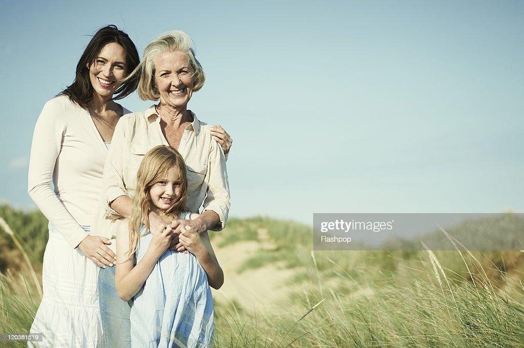 Family portrait of three generations of women : Stock Photo