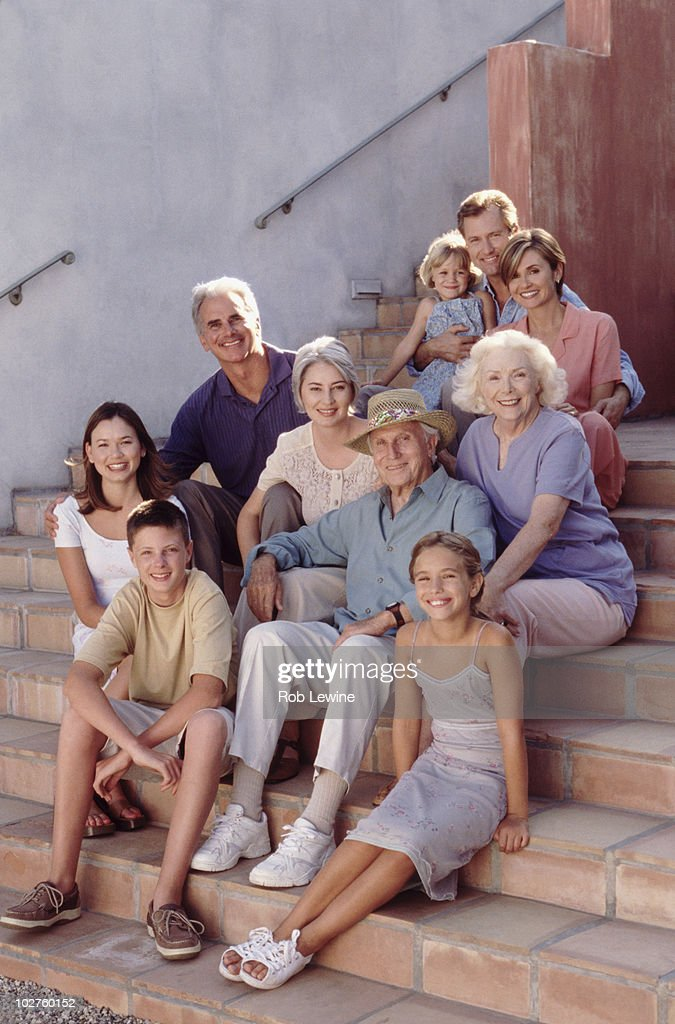 Family portrait on the steps : Stock Photo