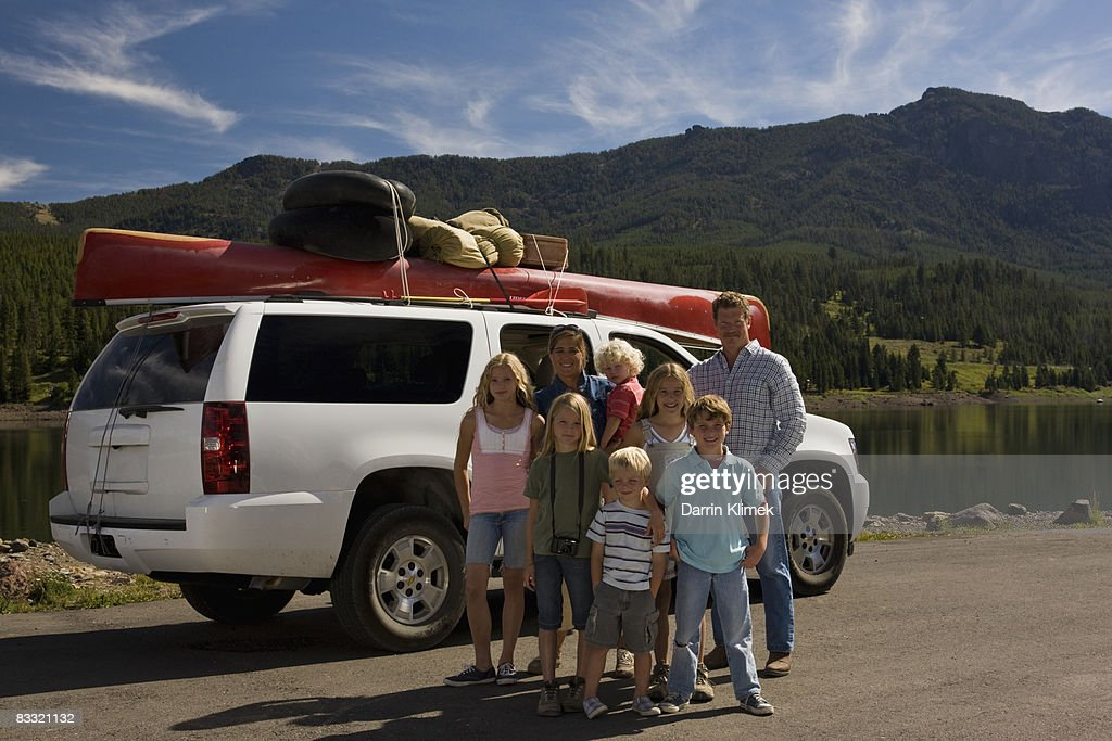 Family Portrait with car and mountains   : Stock Photo
