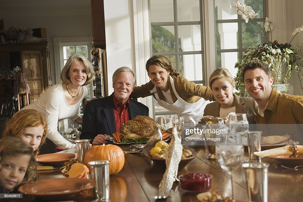 Family portrait with Thanksgiving dinner