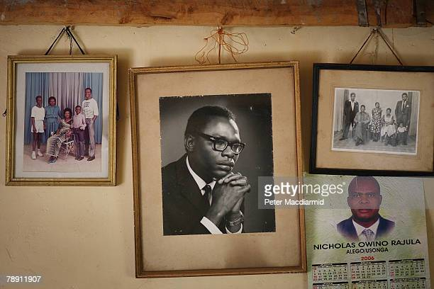 Family portraits including one of US Senator Barack Obama's father hang in his family house on January 12 2008 in Kogelo western Kenya Barack Hussein...