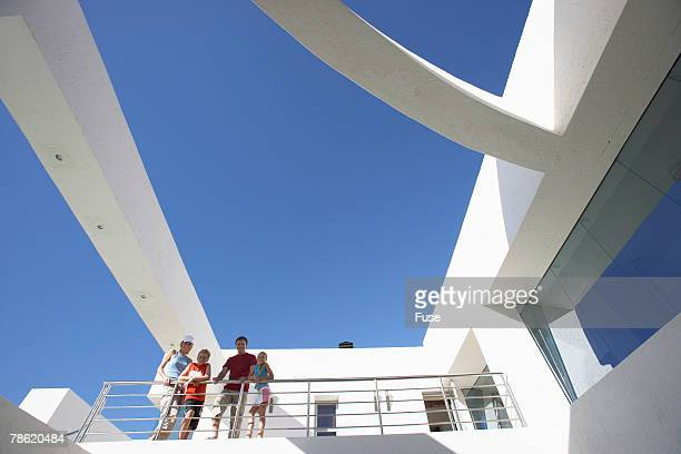 Family Posed on Balcony of Building