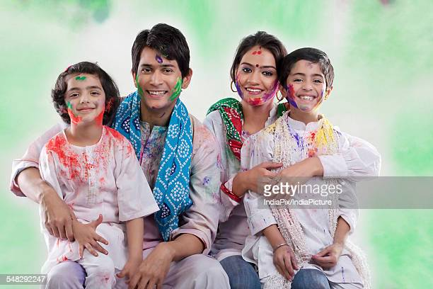Family posing after playing holi