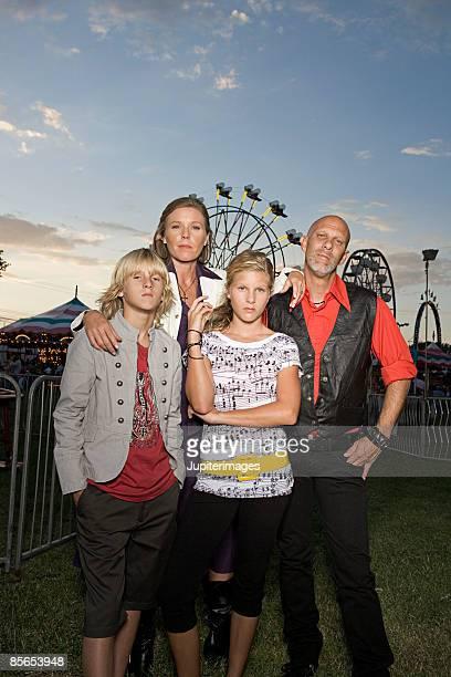 Family posing at fairgrounds