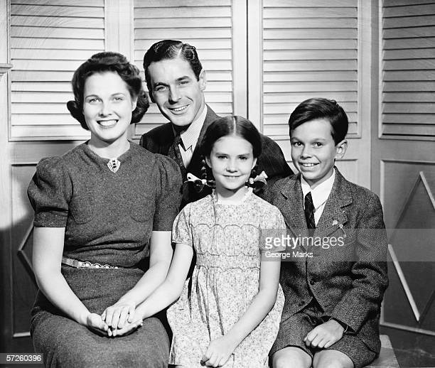 Family posing at home, children (8-9) (10-11), (B&W), portrait