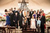 Family posing at wedding in church