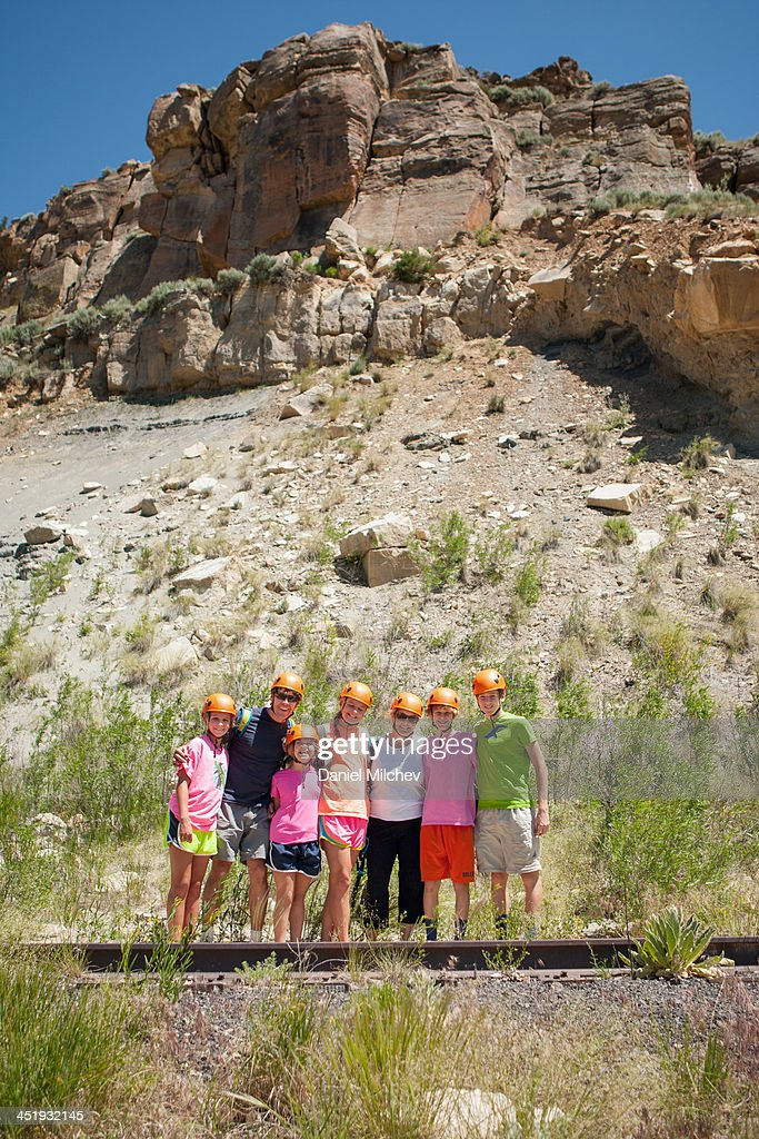 Family posing for a portrait, after rock climbing. : Stock Photo