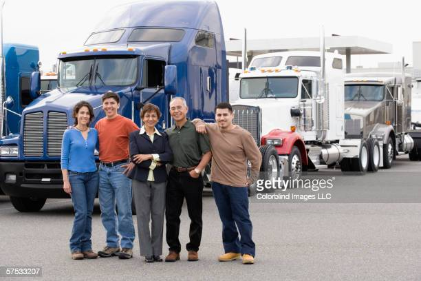 Family posing for the camera in truckyard