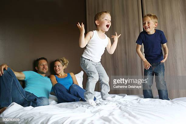 A family posing on a bed