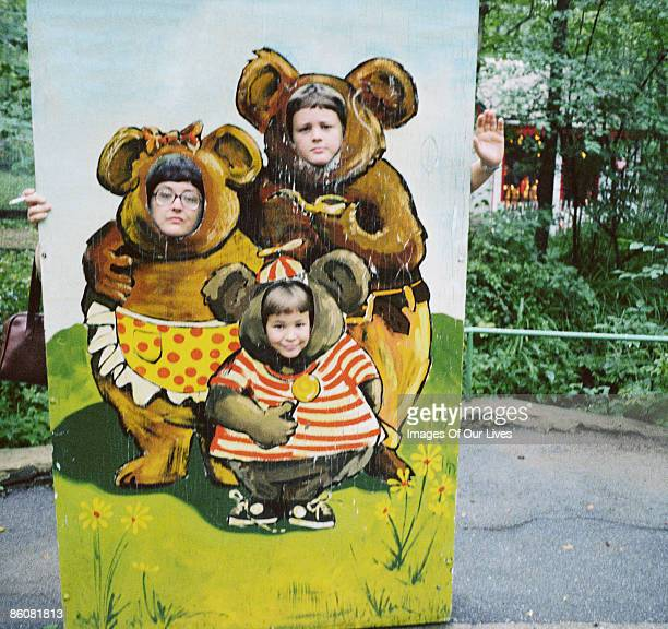 Family posing with amusement park cut-out