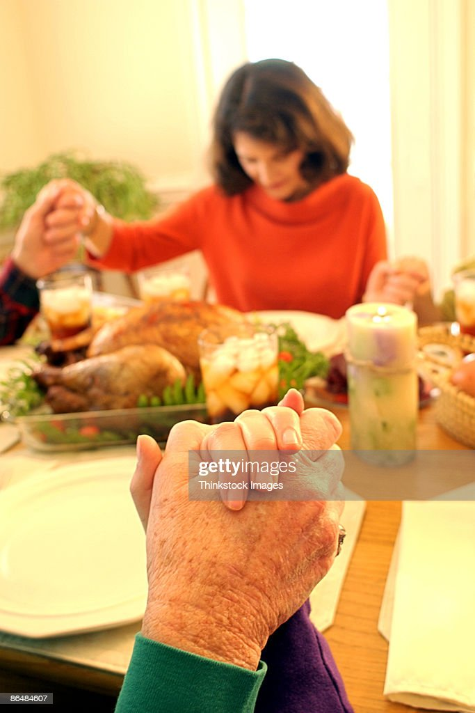 Family praying before meal : Stock Photo
