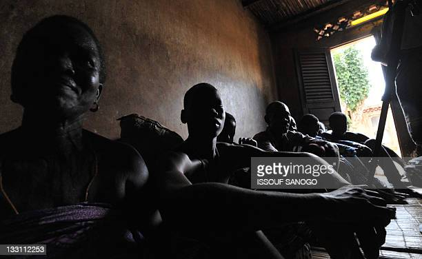 A family prepares a voodoo ceremony on November 16 2011 in Ouidah 40km from Cotonou Pope Benedict XVI makes his second visit to Africa as pontiff...