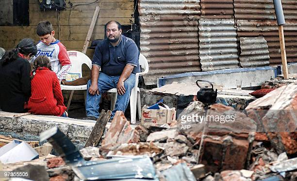 A family prepares their breakfast amid the rubble from buildings in Concepcion on March 1 after a massive 88magnitude rocked Chile last Febraury 27...