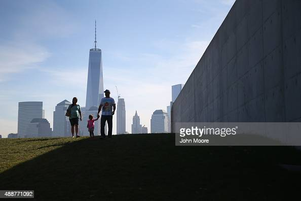 A family prepares to take part in a naturalization ceremony at Liberty State Park on September 17 2015 in Jersey City New Jersey The group...