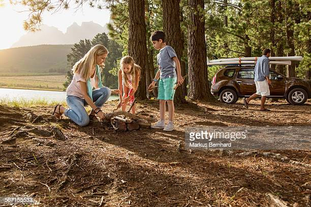 Family preparing a fire place.