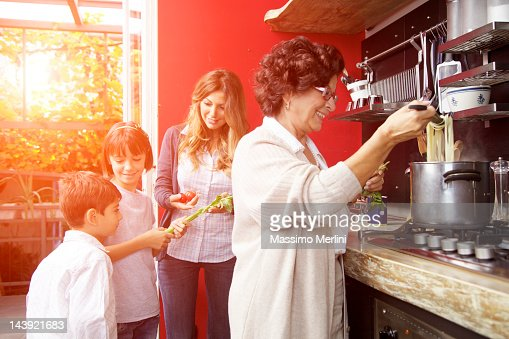 Family preparing a meal together : Stock Photo
