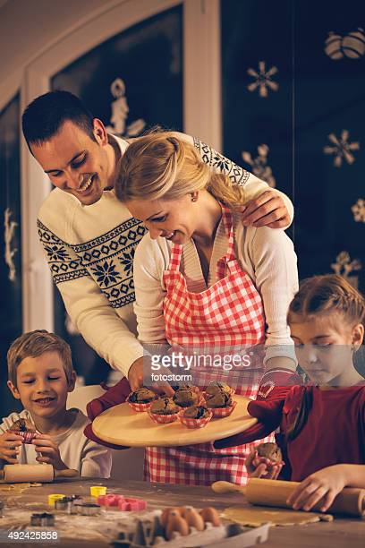Family preparing Christmas sweet food together