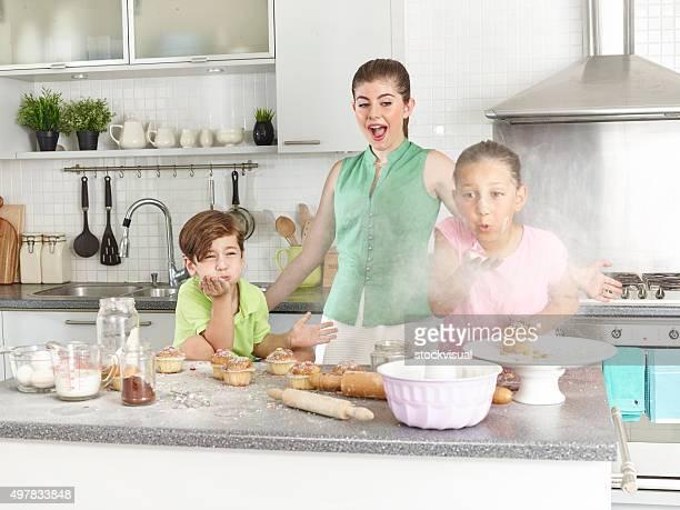 Family Preparing Cupcake In Kitchen