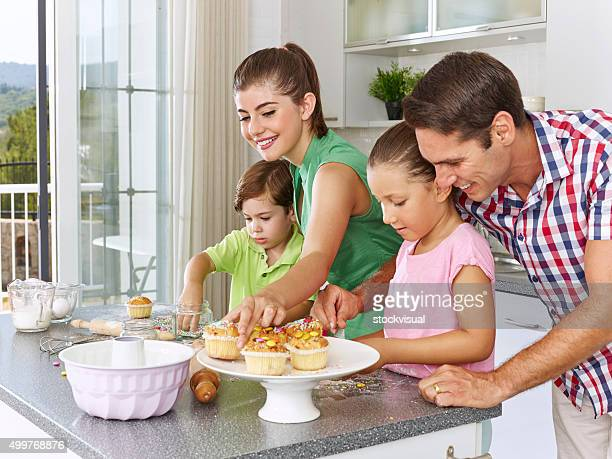 Family preparing cupcakes in the kitchen
