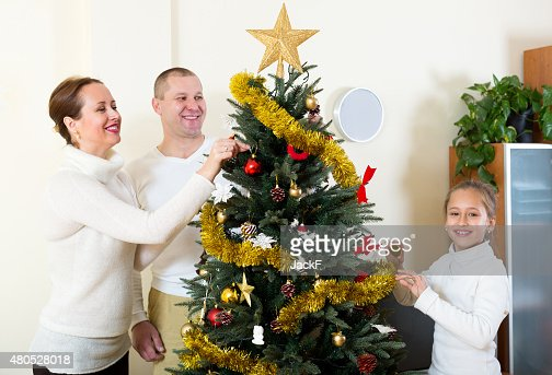 family preparing for Christmas : Stock Photo