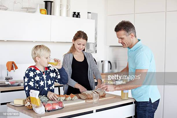 Family preparing healthy breakfast