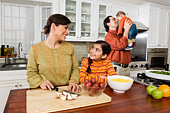 Family preparing holiday meal in kitchen