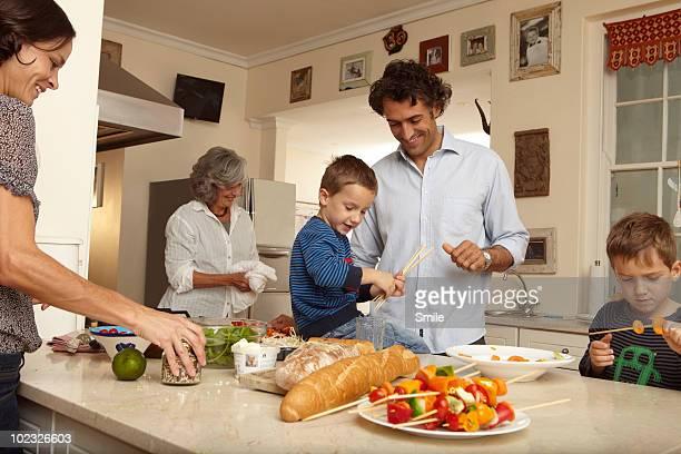 Family preparing lunch in kitchen