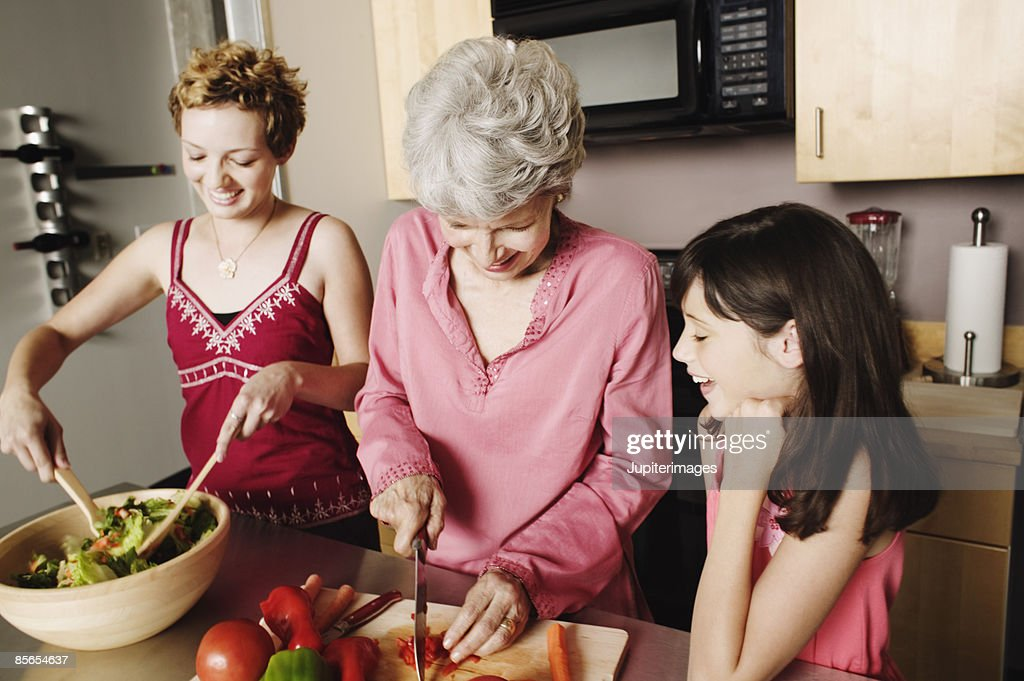 Family preparing salad : Stock Photo