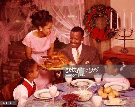 Family preparing to eat Christmas dinner : Stock Photo