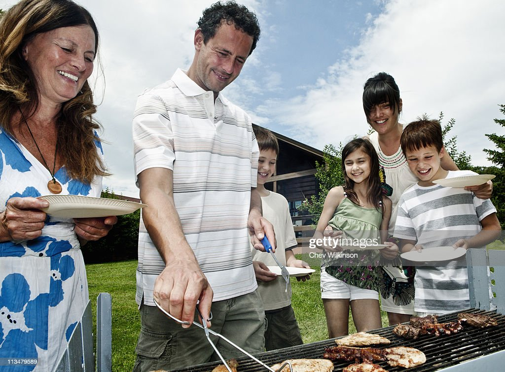 Family queueing for barbeque : Stock Photo