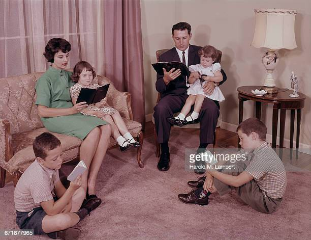 Family Reading Bible In Living Room