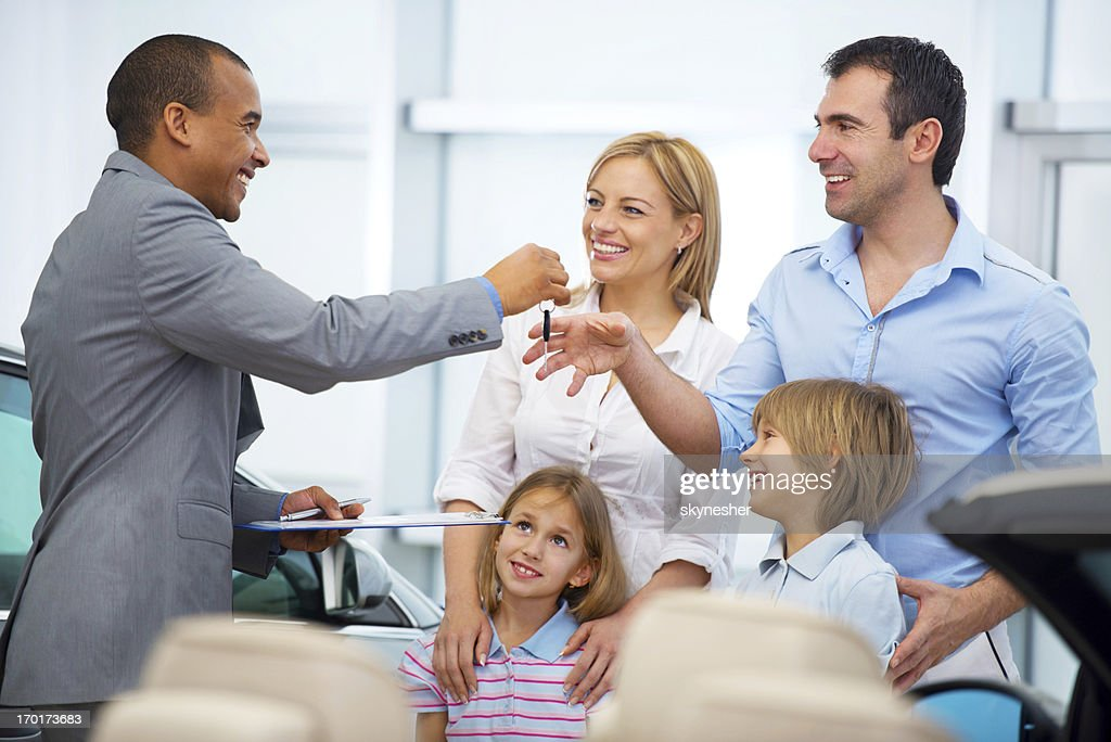 Family receiving a new car keys.