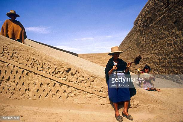 A family relaxes at Huaca Arco Iris known locally as Huaca del Dragon The names mean 'rainbow temple' and 'dragon temple' respectively and refer to...