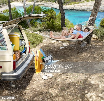 Family relaxes in a hammock
