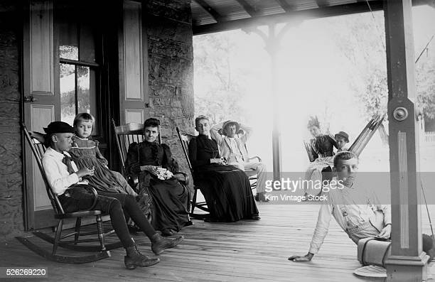 Family relaxes on the porch ca 1903