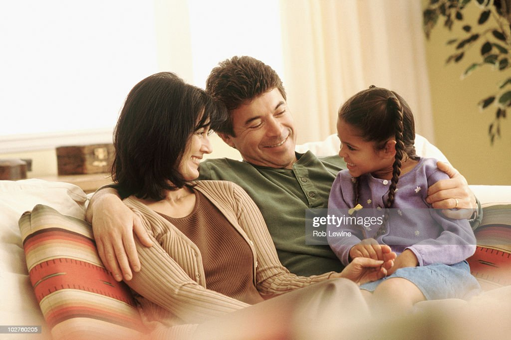 Family relaxing at home : Stock Photo