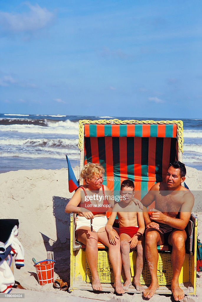 Family relaxing in beach-chair, North Sea : Stock Photo