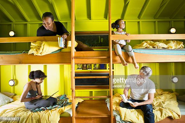 Family relaxing in bunk beds at camp